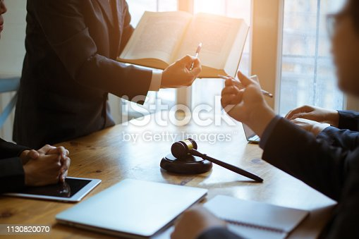 Group of business people and lawyers discussing contract papers ,Consultation between a male lawyer and businessman concept