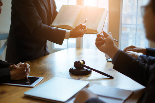 Group of business people and lawyers discussing contract papers ,Consultation between a male lawyer and businessman concept Group of business people and lawyers discussing contract papers ,Consultation between a male lawyer and businessman concept jurist stock pictures, royalty-free photos & images