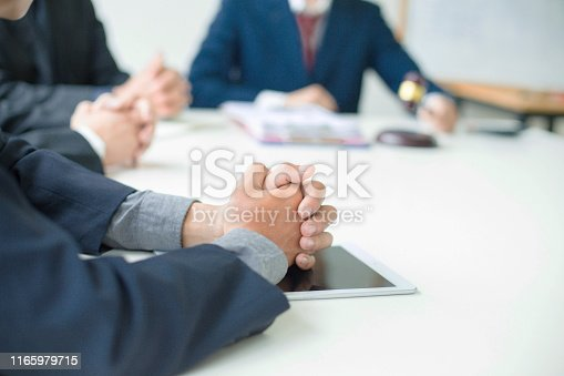 istock Group of business people and lawyers discussing contract papers ,Consultation between a male lawyer and businessman concept 1165979715