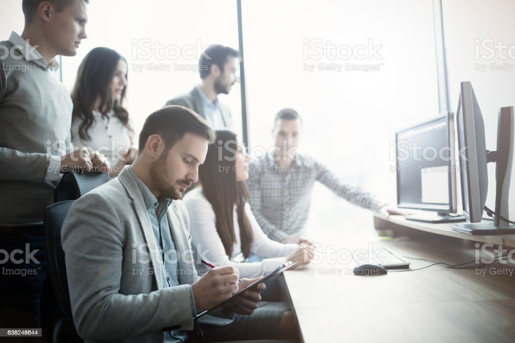 Group of business people and software developers working stock photo