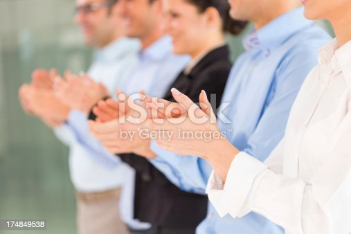 497183120 istock photo Group of business people applauding 174849538