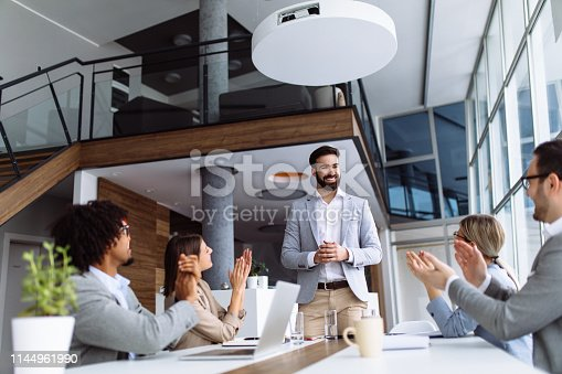 924519152 istock photo Group of business people applauding team leader after presentation 1144961990