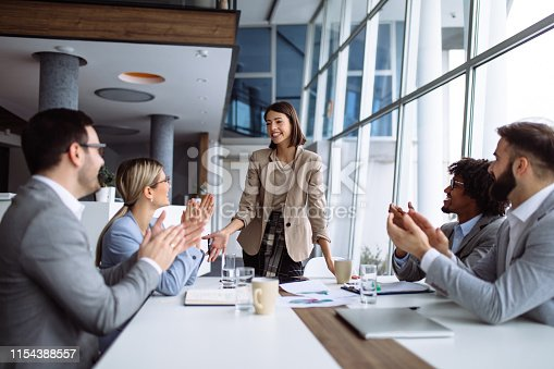 924519152 istock photo Group of business people applauding team leader after presentation 1154388557