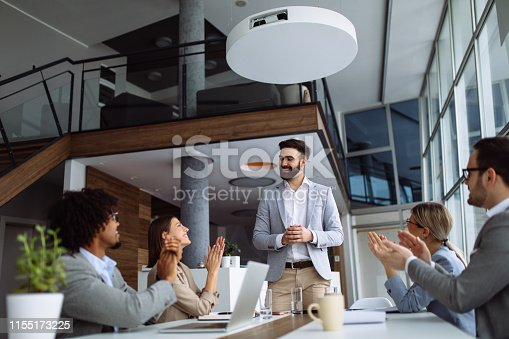 924519152 istock photo Group of business people applauding team leader after presentation 1155173225