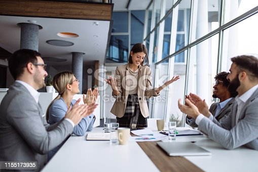 924519152 istock photo Group of business people applauding team leader after presentation 1155173935