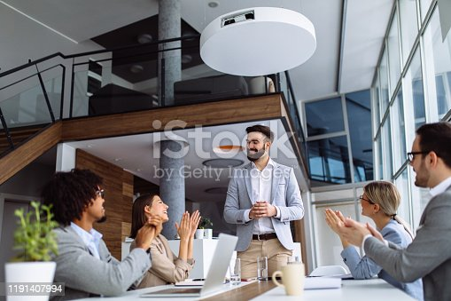 924519152 istock photo Group of business people applauding team leader after presentation 1191407994