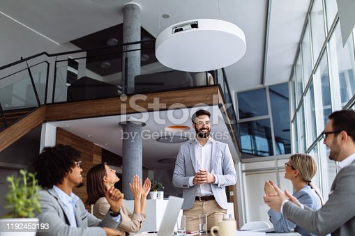 924519152 istock photo Group of business people applauding team leader after presentation 1192453193