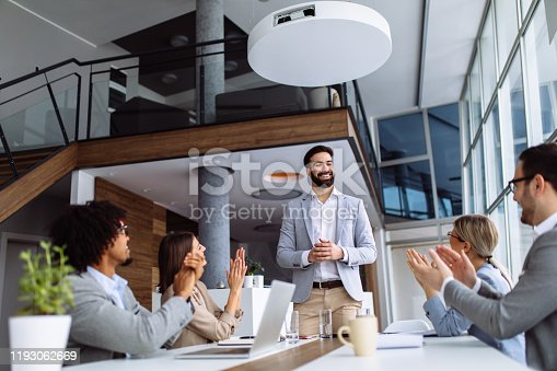 924519152 istock photo Group of business people applauding team leader after presentation 1193062669