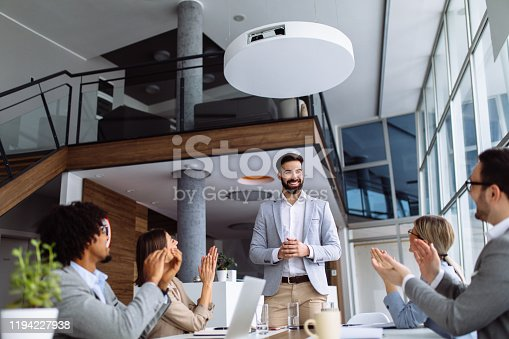 913332100 istock photo Group of business people applauding team leader after presentation 1194227938