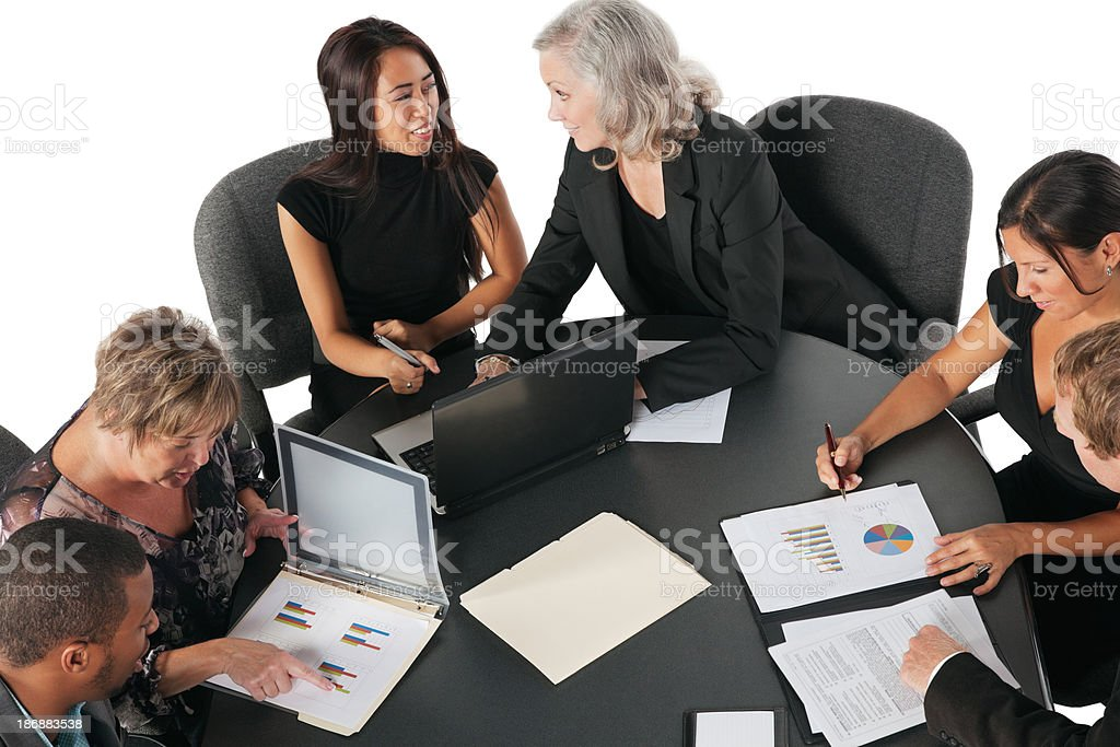 Group of Business People at Conference Table Discussing Sales Figures royalty-free stock photo