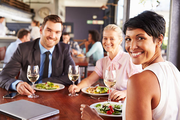 Group of business people at lunch in a restaurant stock photo