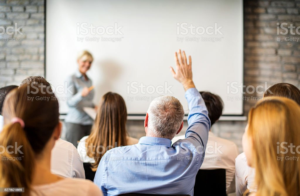 Group of business people at seminar. stock photo
