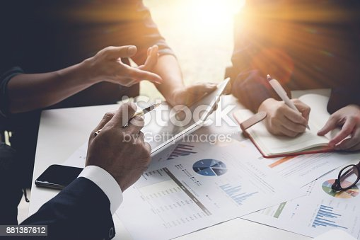 istock Group of business people busy discussing financial matter during meeting. Corporate Organization Meeting Concept with vintage tone 881387612