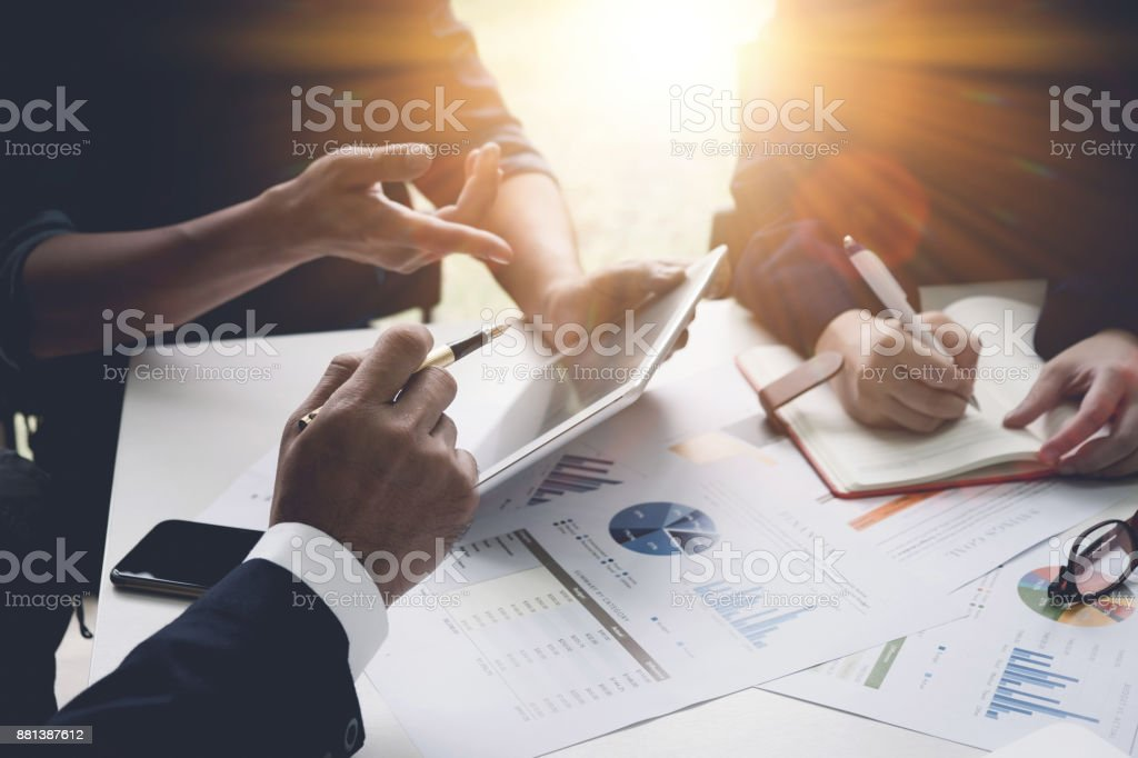 Group of business people busy discussing financial matter during meeting. Corporate Organization Meeting Concept with vintage tone stock photo
