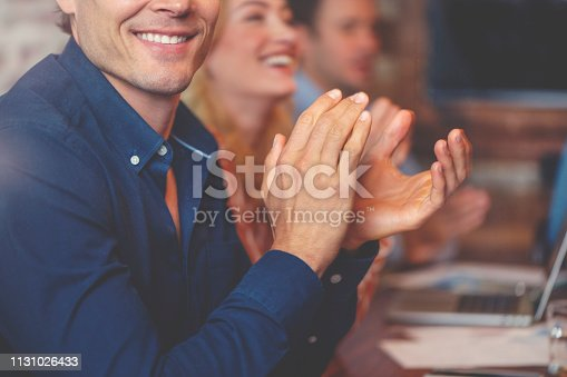 istock Group of business people clapping at a seminar. 1131026433