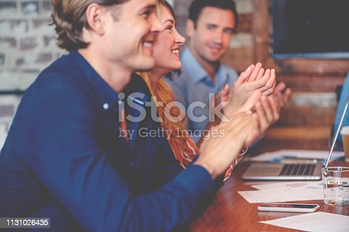 istock Group of business people clapping at a seminar. 1131026435