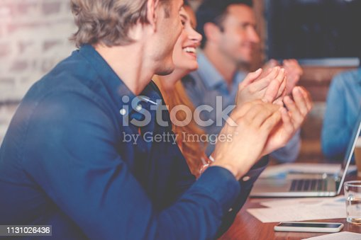 istock Group of business people clapping at a seminar. 1131026436