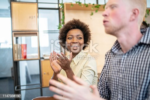511305456 istock photo Group of business people clapping hands during seminar 1147338192