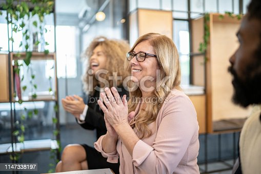511305456 istock photo Group of business people clapping hands during seminar 1147338197