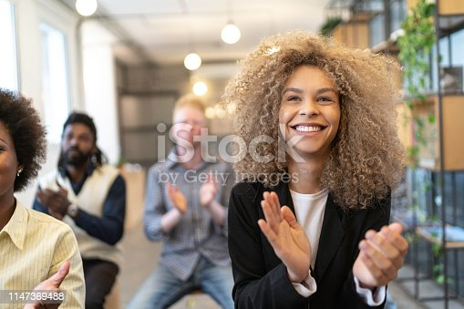 894290604 istock photo Group of business people clapping hands during seminar 1147369488