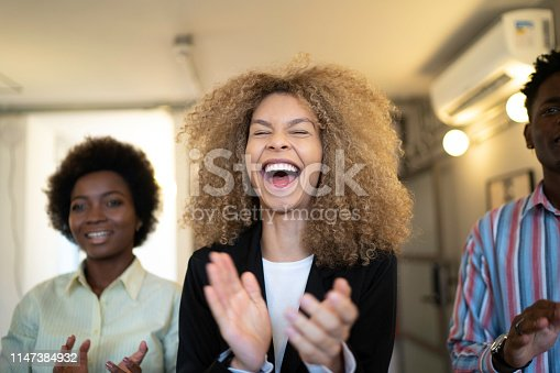 894290604 istock photo Group of business people clapping hands during seminar 1147384932
