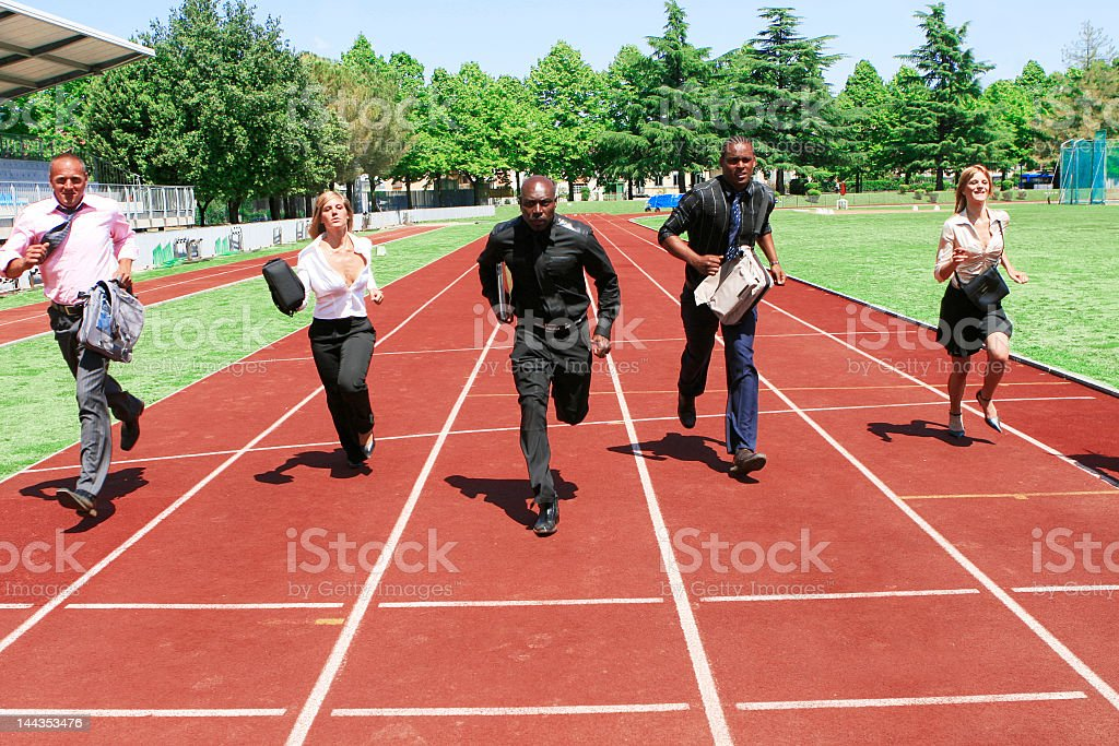 Group of business people competing on a running track stock photo