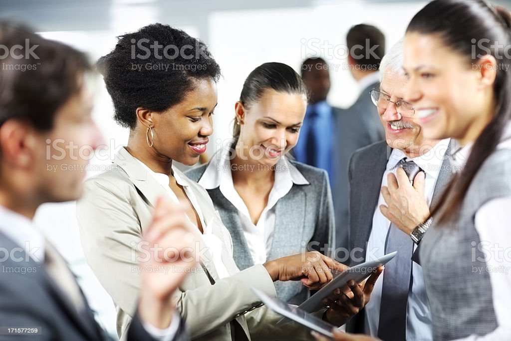 Group of  business people discussing and  working on a touchpad royalty-free stock photo