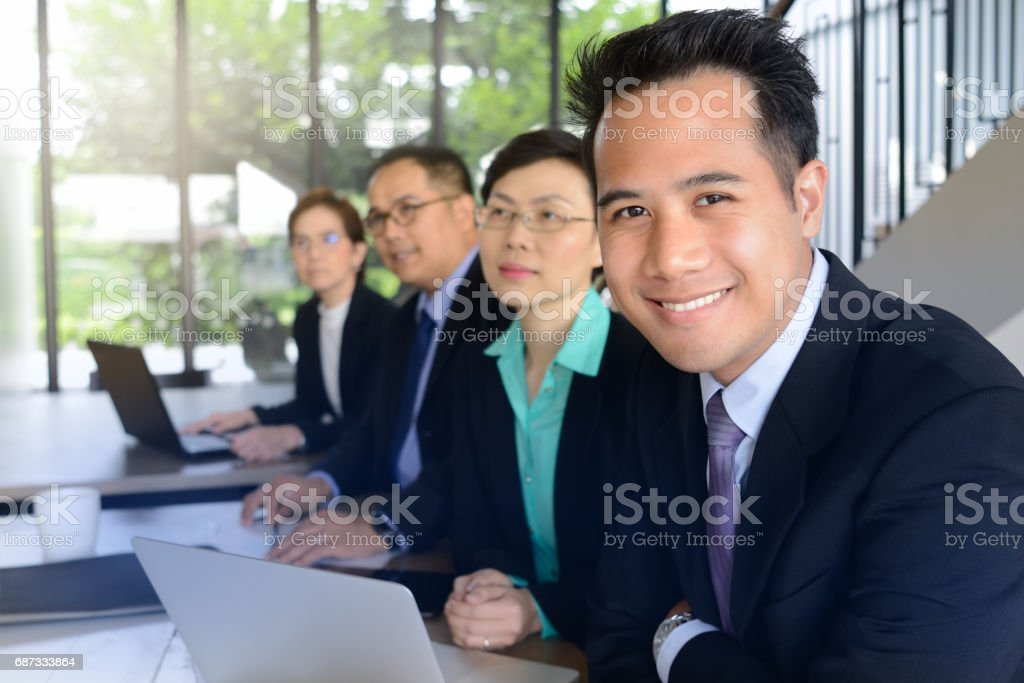 Group of business people discussing and working together during a meeting in office stock photo