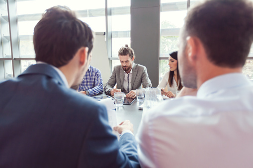 Group Of Business People Discussing At Conference Table Stock Photo - Download Image Now