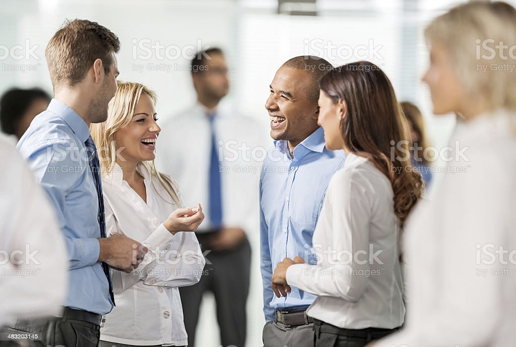 Group of business people discussing. stock photo