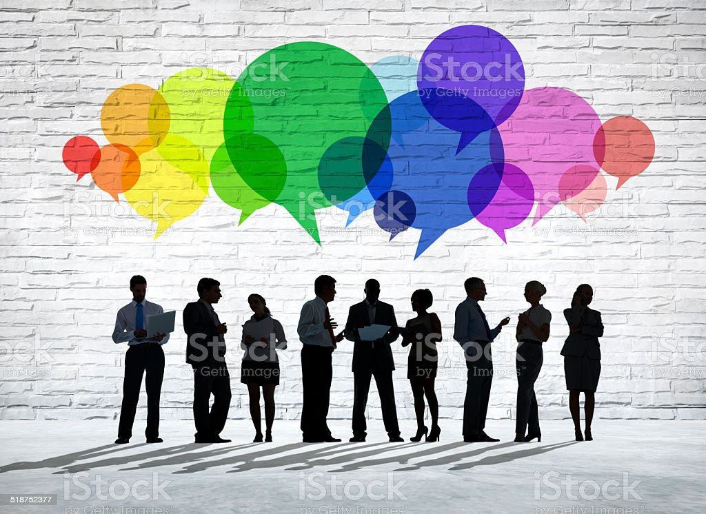 Group of Business People Discussing With Colourful Speech Bubbles stock photo