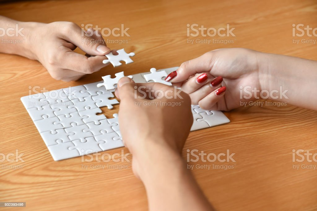Group of Business people hands are connecting jigsaw puzzle. stock photo
