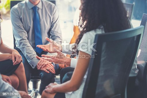 istock Group of business people having a discussion. 987123762