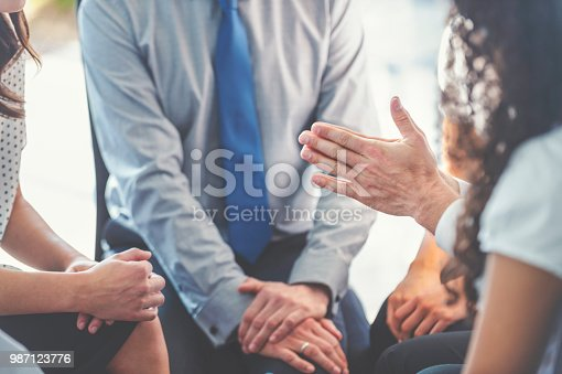 istock Group of business people having a discussion. 987123776