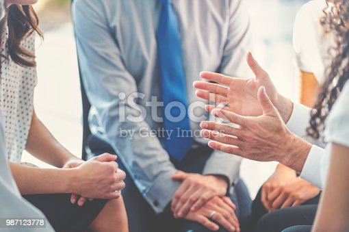 istock Group of business people having a discussion. 987123778