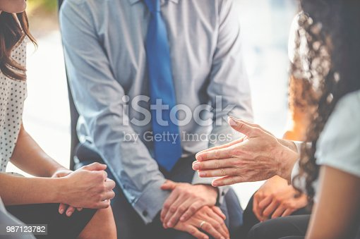 istock Group of business people having a discussion. 987123782