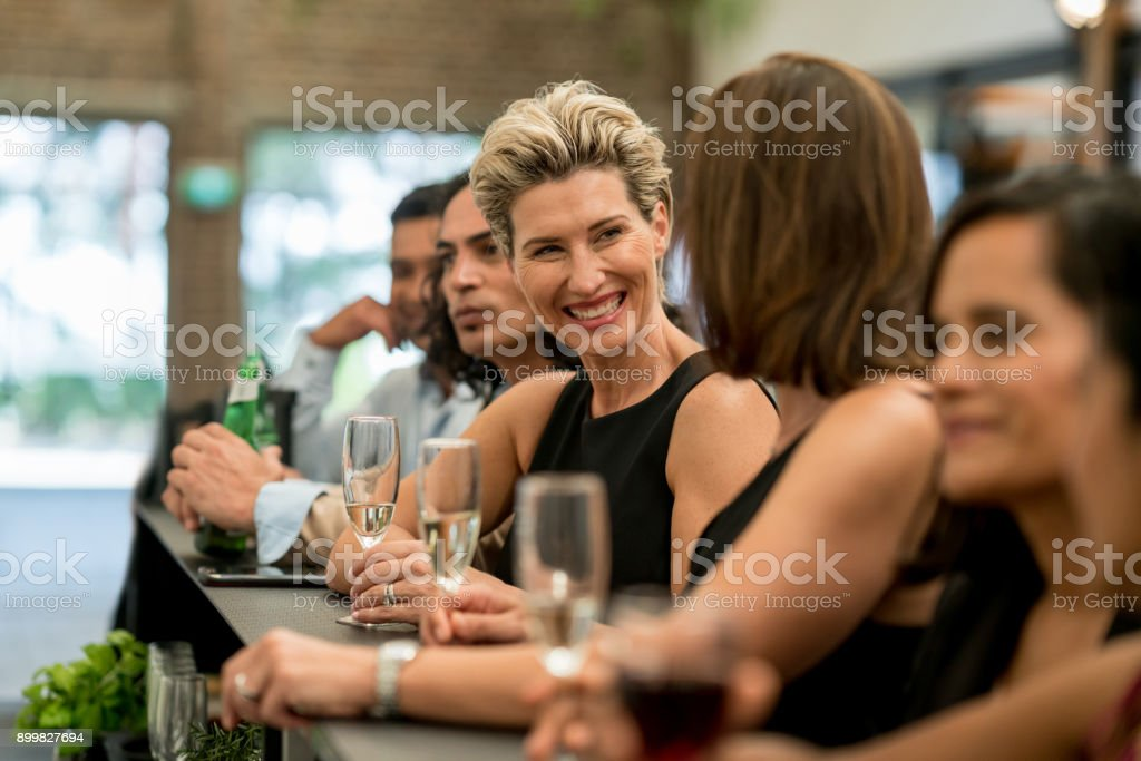 Group of business people having drinks at a bar stock photo
