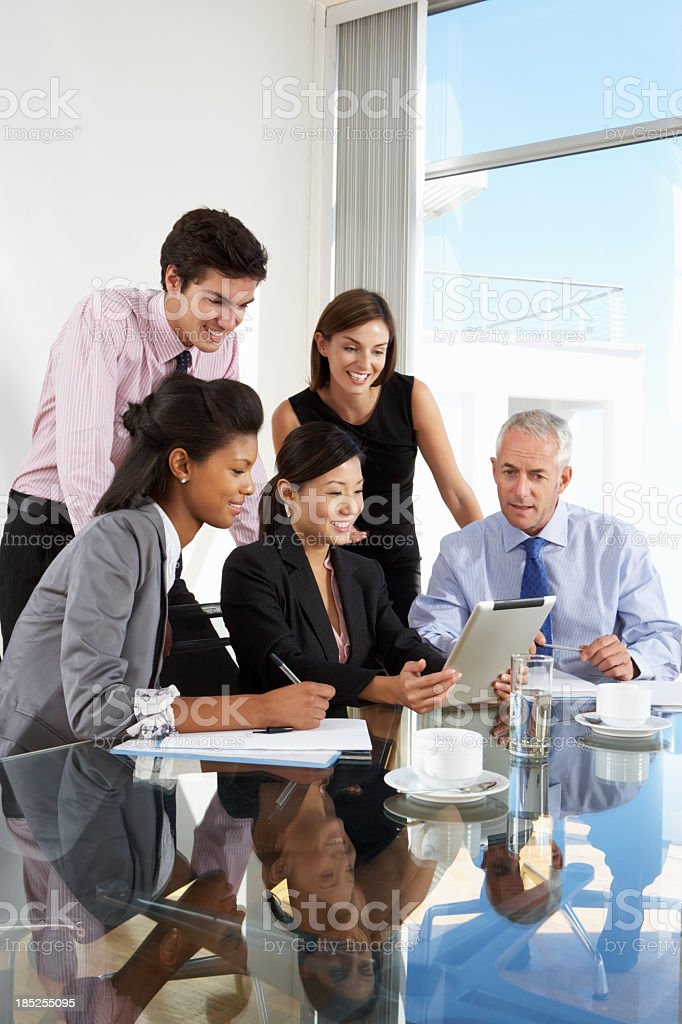 Group Of Business People Having Meeting Around Tablet Computer royalty-free stock photo