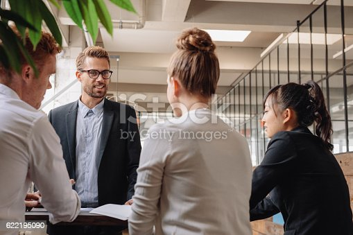 istock Group of business people having meeting together 622195090
