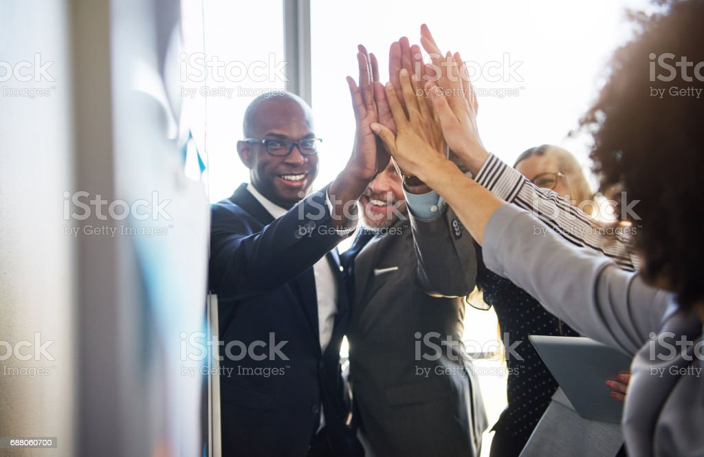 Group of business people high five looking positive - foto stock