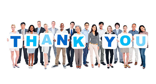 Group Of Business People Holding Placards Forming Thank You stock photo