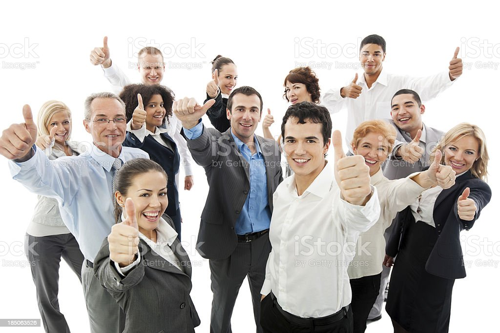 Group of business people holding up their thumbs stock photo