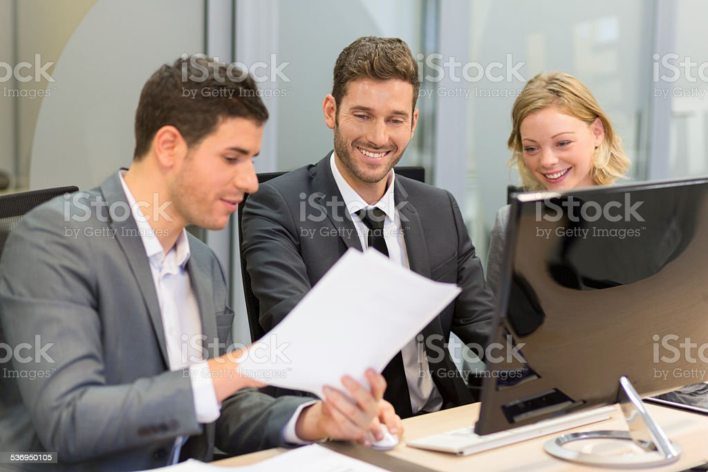 Group of business people in a meeting, working on computer royalty-free stock photo