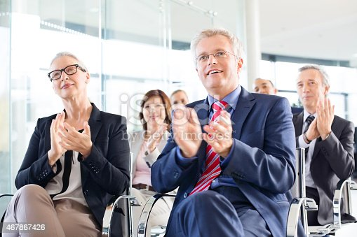 1180918029 istock photo Group of business people in a seminar applauding 467867426