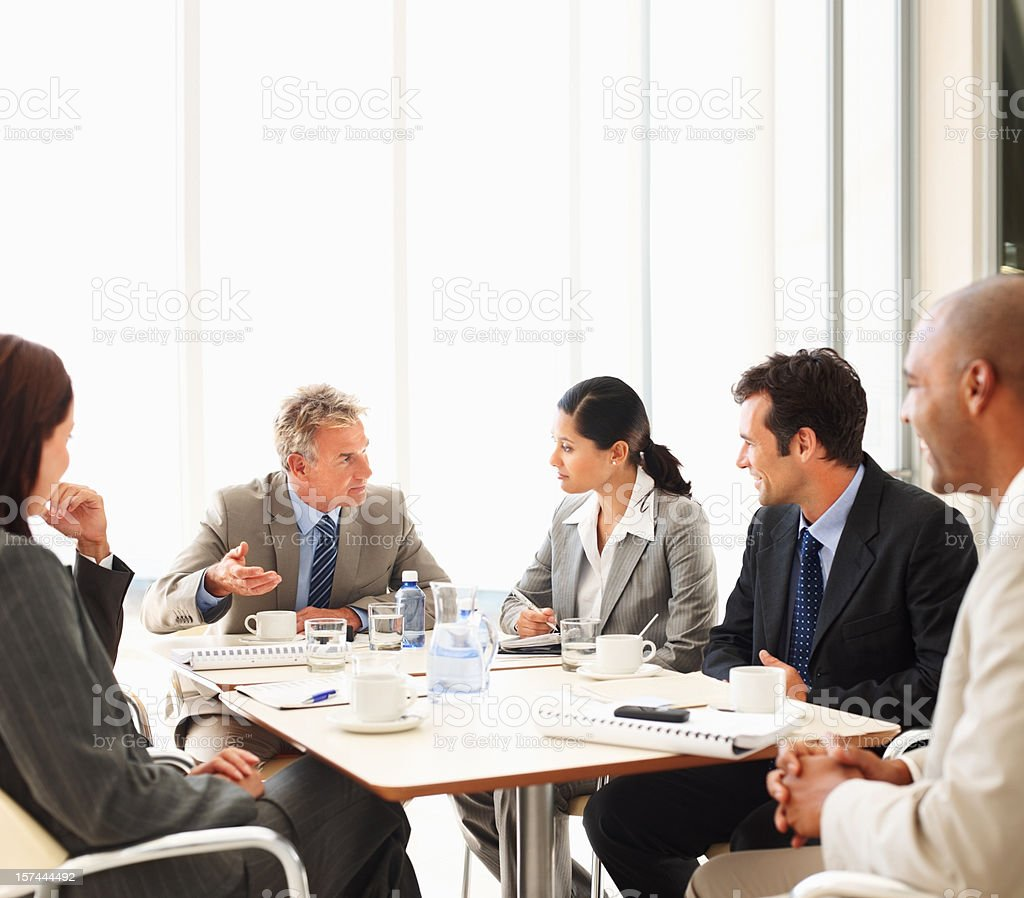Group of business people in meeting having discussion royalty-free stock photo