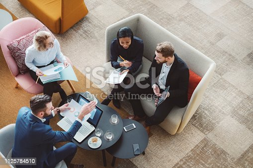 Group of business people in office cafeteria.