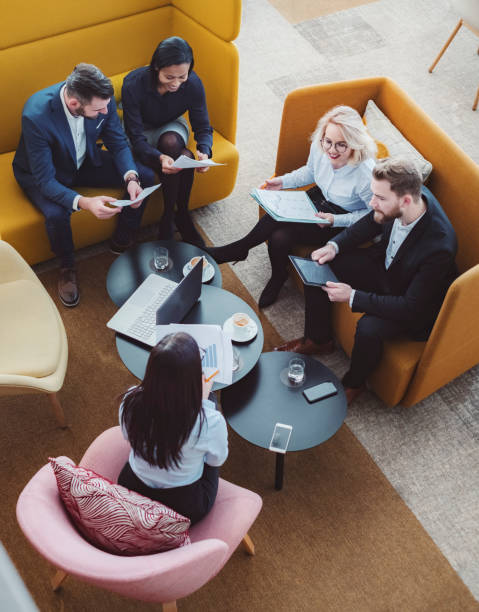 group of business people in office cafeteria - business meeting, table view from above foto e immagini stock