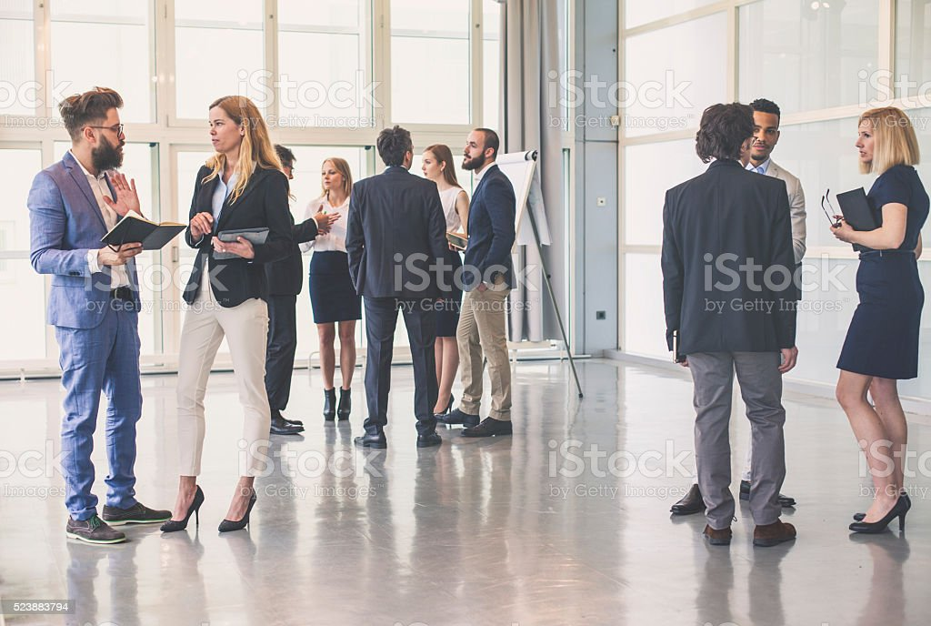 Group of business people in the office building stock photo