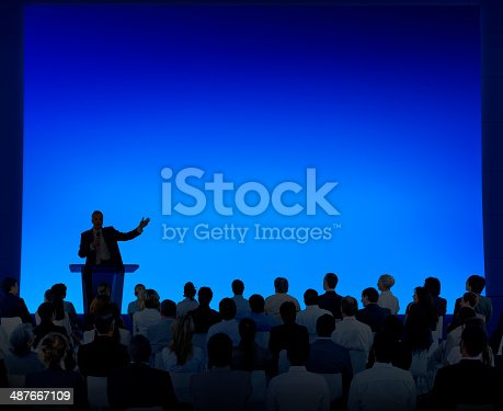 istock Group Of Business People Listening To A Speech 487667109
