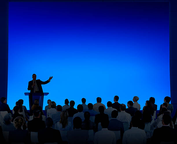 Group Of Business People Listening To A Speech Group Of Business People Listening To A Speech speech stock pictures, royalty-free photos & images